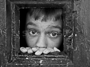 278803_stock-photo-face-through-prison-window